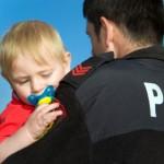 Police holding child