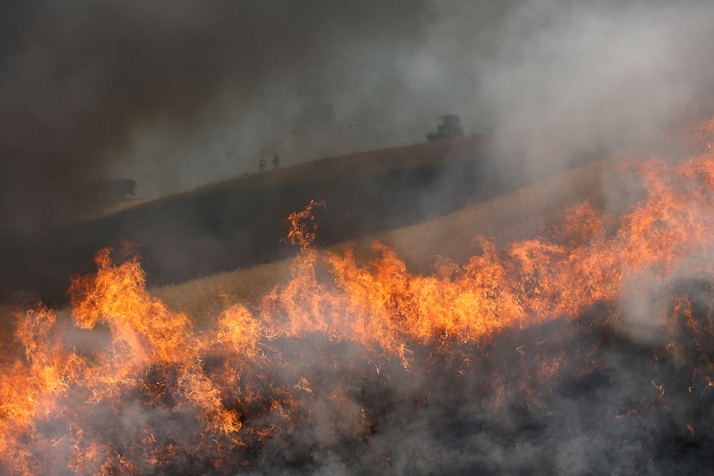 Faulty Vehicle Exhaust Blamed for Igniting Apple Fire