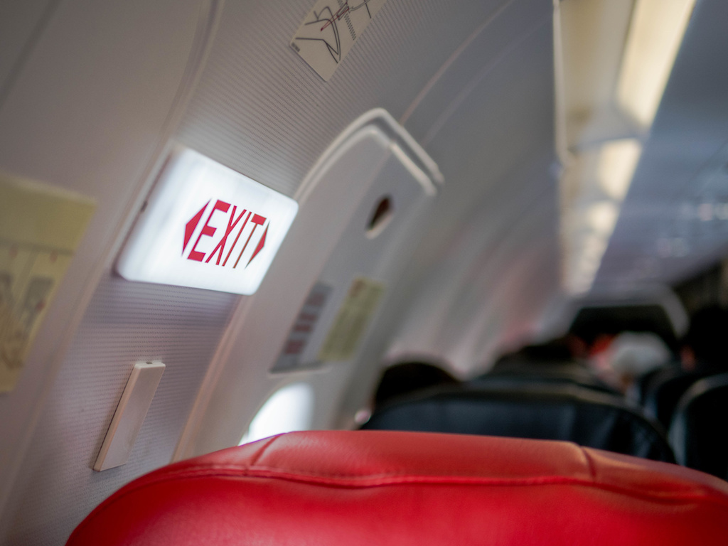 She Meant To Go To The Bathroom. She Opened The Plane's Emergency Exit Instead.