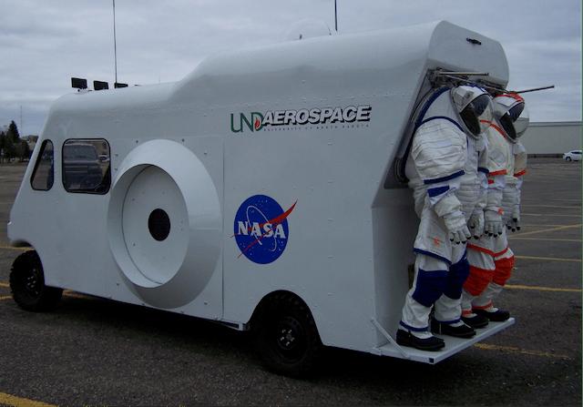 ILMAH EVA rover and spacesuits
