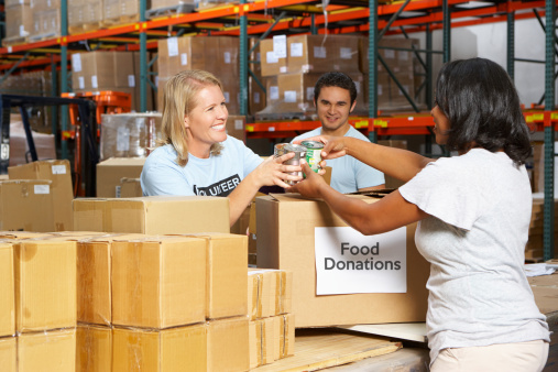 Volunteers Collecting Food Donations In Warehouse nonprofit