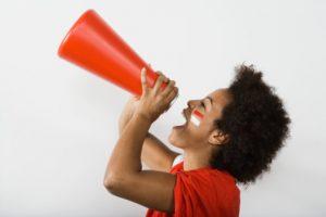 Young Woman Shouting Through Megaphone