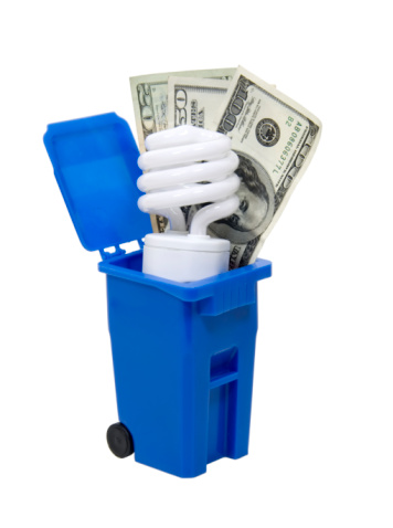 Recycle bin and spiral lightbult with large bills of money to show efficient recycling - path included