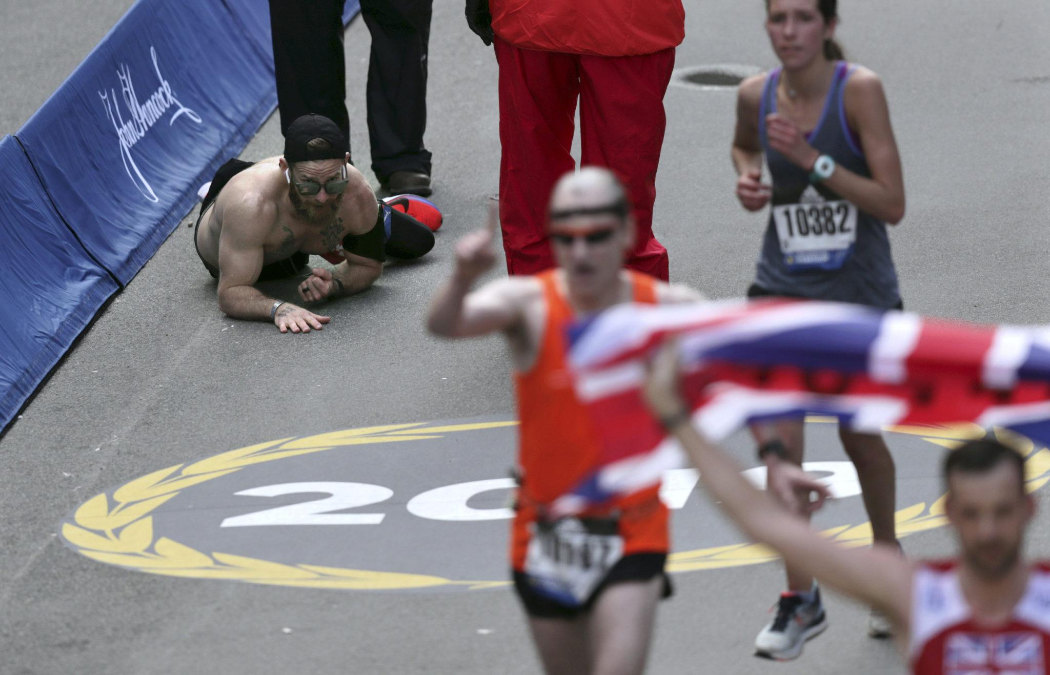 Marine running marathon for fallen friends crawls to finish
