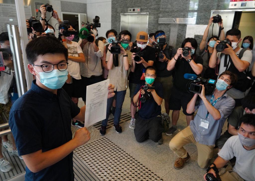 Hong Kong activist Joshua Wong seeking seat in legislature