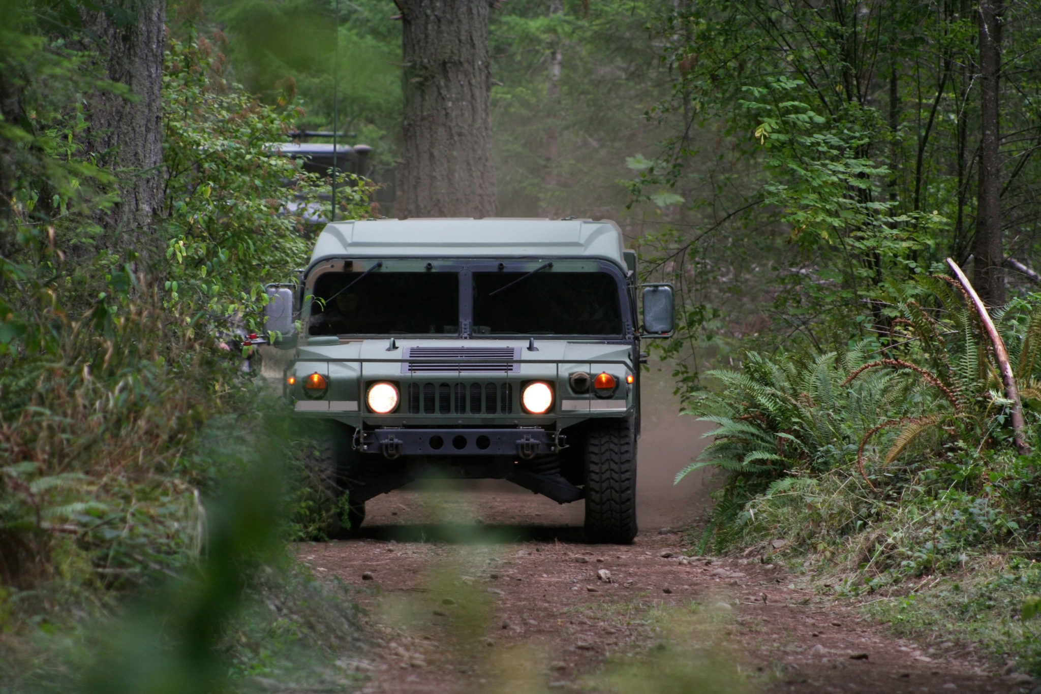 Marines in Humvees refine their combat driving skills in jungles of Okinawa